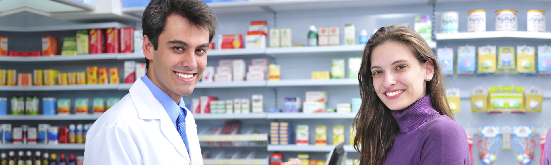 male pharmacist and a female costumer smiling