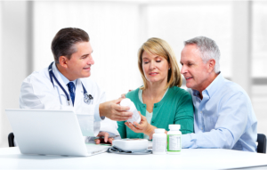 Couple talking to a pharmacist during a consultation