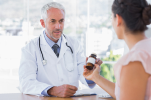 Pharmacist giving the customer a free antiobiotic